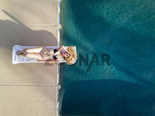 Blonde Bikini Model By The Pool