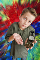 Boy hold a compass on colourful background