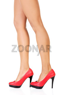 Attractive female legs in red high heels.