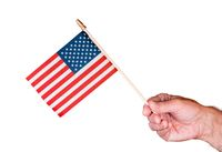 Senior man hand holding a small USA flag isolated against white