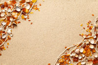 Ambers And Seashells On Sea Sand Background