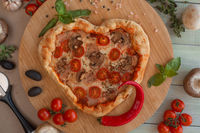 Pizza heart shaped on wood