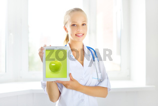 Female doctor with tablet pc