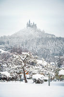 Castle Hohenzollern in Germany by snowy winter
