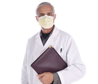 Portrait of a middle aged doctor wearing a surgical mask and lab coat holding a notebook under his arm. Isolated on white.