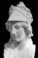 Greek ancient statue of goddess Athena. Woman marble head in helmet sculpture isolated on black