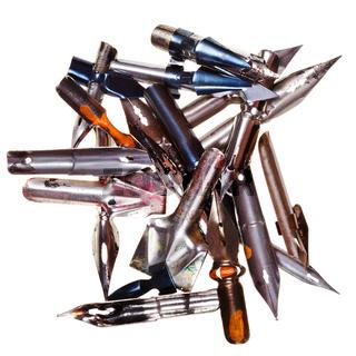 heap of used metal nibs