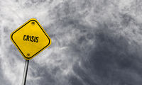 Yellow crisis sign with cloudy background