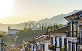 Old houses and churches in colonial architecture from the 18th century at sunset