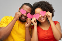 happy african american couple with hearts