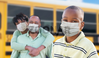 Young African American Student and Parents Near School Bus Wearing Medical Face Masks During Coronavirus Pandemic