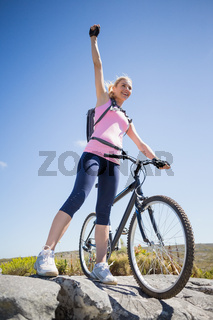 Fit pretty cyclist on a rocky terrain