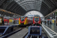 Trains and unidentified passengers in the central station of Frankfurt am Main, Germany