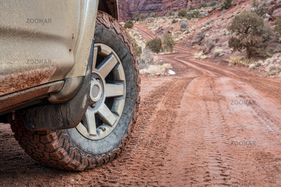 4x4 SUV car or truck driving on a dirt canyon road