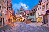 Rothenburg ob der Tauber. German street architecture of medieval German town of Rothenburg ob der Tauber evening view