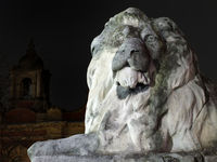detail of lion sculpture outside leeds town hall at night