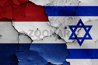 flags of Netherlands and Israel painted on cracked wall