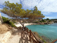 Empty pathway fenced with wooden railings lead to Benissa beach. Spain