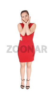 Pretty woman standing with her hands on her face