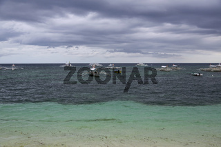 Fisherman Boats on the Ocean at Alona Beach on Panglao Island