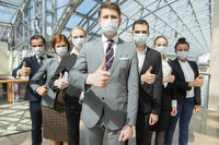 Successful business people wearing masks