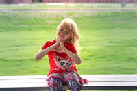 A little girl sitting in the park