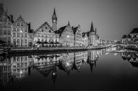 Leie river bank in Ghent, Belgium, Europe at dusk in black and white.