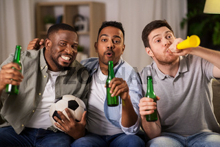 friends or soccer fans with ball and beer at home