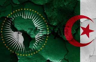 flags of African Union and Algeria painted on cracked wall
