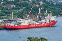 Russian cargo container ship nuclear-powered icebreaker Sevmorput Corporation FSUE Atomflot or Rosatomflot. Container terminal commercial seaport. Pacific Ocean