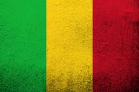 the Republic of Mali National flag. Grunge background