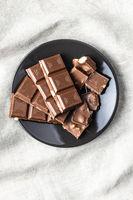 Milk chocolate bar on plate.