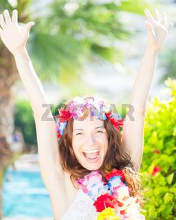 Happy woman enjoying sun on the beach