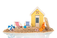 Beach chairs and hut in sand