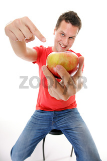 happy man in red shirt pointing the apple