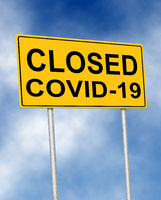 The road sign symbol with text Closed Covid-19