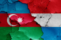 flags of Azerbaijan and Luxembourg painted on cracked wall