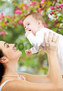 mother with baby over spring garden background