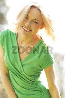 Happy woman in park
