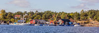 Small harbor and yard of the village Arkosunds in south Sweden