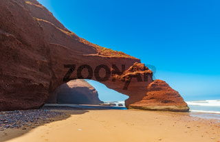 Red arches of Legzira beach, Morocco.