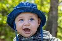 Cheerful baby enjoying in garden
