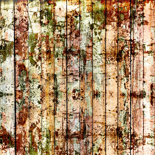 Old painted wooden fence with paint peeling