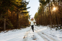 Frolicking in the snow among the forest trees