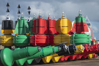 Colorful buoys in storage in a port