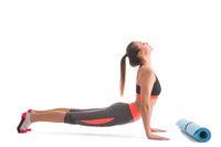 Slim brunette doing yoga excercise profile view