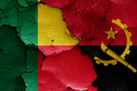 flags of Benin and Angola painted on cracked wall