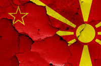 historical flag of Socialist Republic of Macedonia and today North Macedonia flag painted on cracked wall