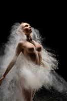 Fit topless female in cloud of dust