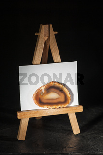 Brown agate slices on a miniature easel